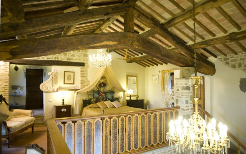 italy wedding venues. The master bedroom inside a chapel of the 13th century, detail of the structural beam.