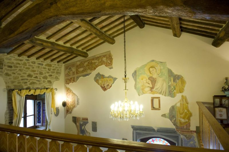 italy wedding venues. Detail of the fresco of Saint Marie on the wall in front of the bedroom.