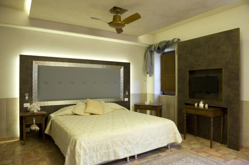 weddings tuscany villa. Detail of the Bedroom and of the flat screen TV.