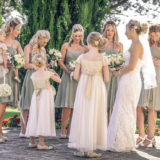 Bride, bridesmaids and flower girl chat before the ceremony starts