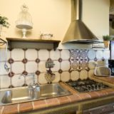Kitchen area with double sink, cooking area, toaster and kettle. wedding tuscany villa