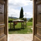 Outside wooden table and chairs for an outdoor meal in the lovely garden. wedding tuscany villa
