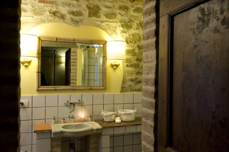 Details of the bathroom with the marble sink and antique mirror. wedding villa tuscany