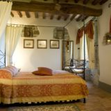 One of the bedrooms and bed in Villa 2. wedding villa tuscany
