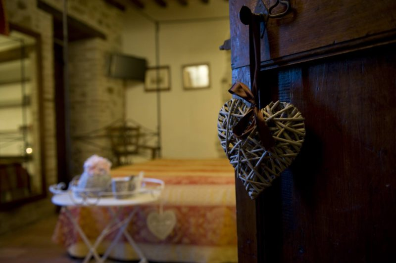 Wooden antique door showing the entrance to one of the bedrooms. wedding villa tuscany