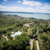 Pool Wedding ideas. Amazing view of the pool area, garden temple, villa and Lake Trasimeno.