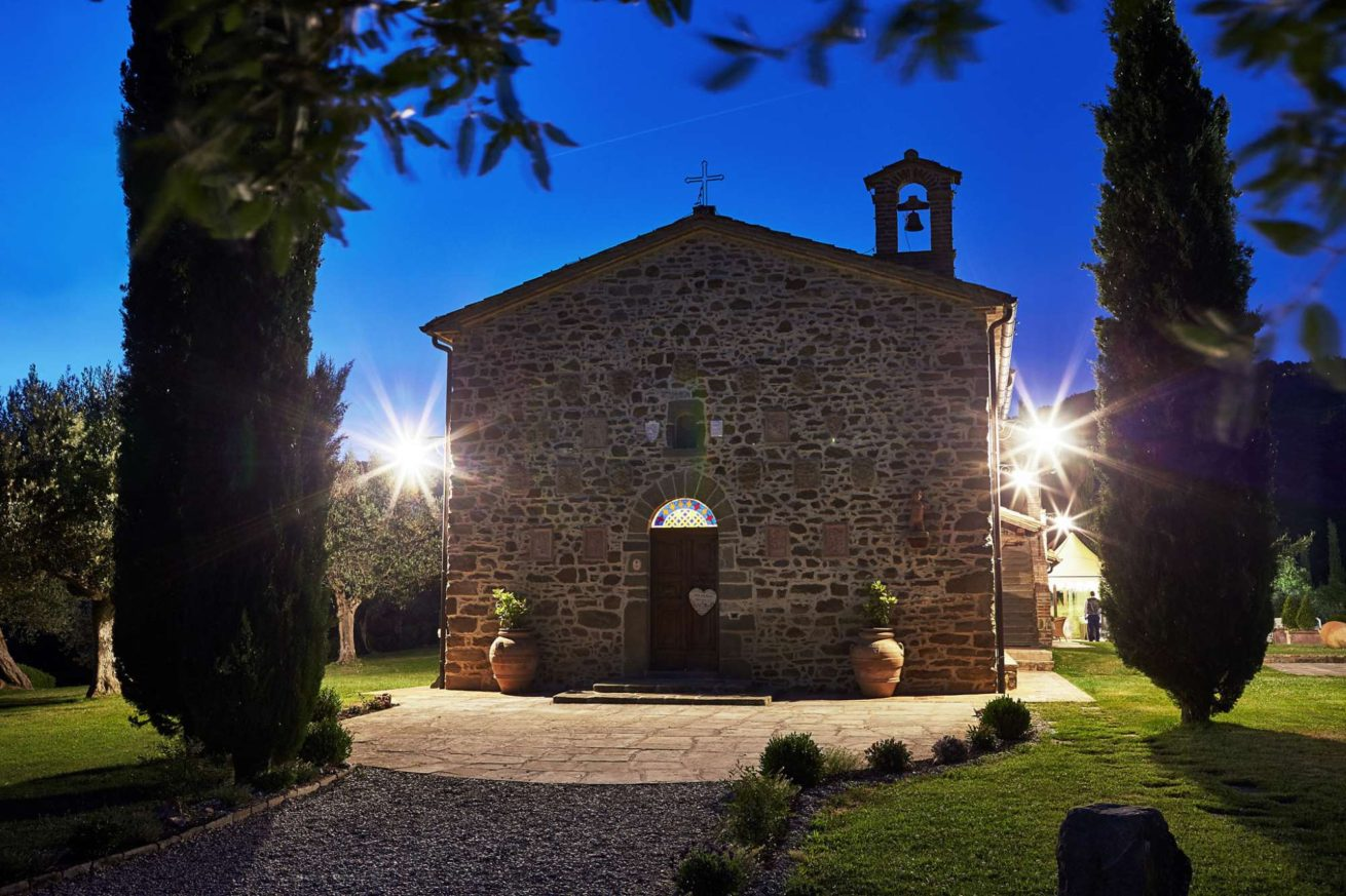 The facade of Exclusive weddings villa Italy San Crispolto chapel at night