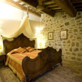 One of the 4 bedrooms, all are supplied with antique furniture and fan ceiling.villa wedding Italy