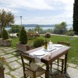 Lovely outdoor furniture enjoying the villa's exclusive garden and amazing view over Lake Trasimeno.villa wedding Italy