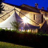 Side view of the Exclusive weddings villa Italy and marquee at night time.