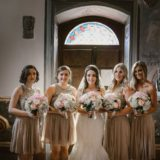 Bride and bridesmaids in the chapel of Villa San Crispolto