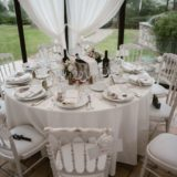 Wedding table decorations in the marquee of villa San Crispolto