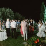 Bridal couple and their guests in the garden at Villa San Crispolto