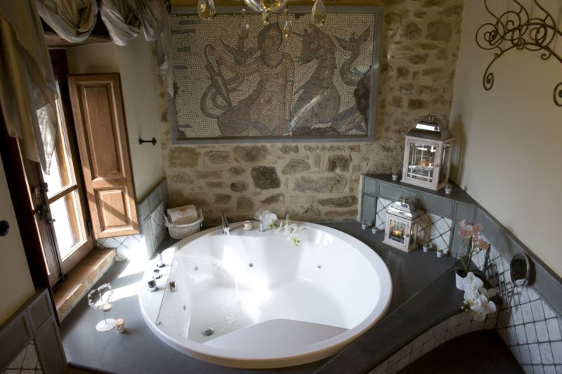 italy wedding venues. A further details of the Jacuzzi tub with the window overlooking Lake Trasimeno.