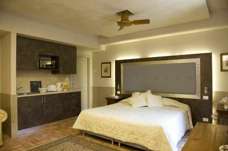 italian wedding villas. Detail of the bedroom, kitchen area and ceiling fan.