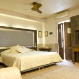 italian wedding villas. Detail of the bedroom and of the flat screen TV.