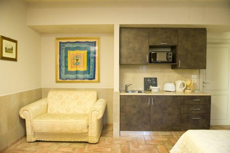 weddings tuscany villa. Detail of the Single Sofa bed and kitchen area with microwave.