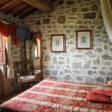 One of the bedroom and the view of the window to witness the peculiarity of the Tuscan countryside.villa wedding Italy