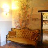 Antique sofa and original fresco witnessing how unique the villa is.villa wedding Italy
