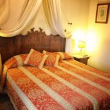 One of the bedrooms in Villa 1, antique bed witnessing the originality of the villa.villa wedding Italy