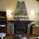 Detail of the frescoed fireplace.villa wedding Italy