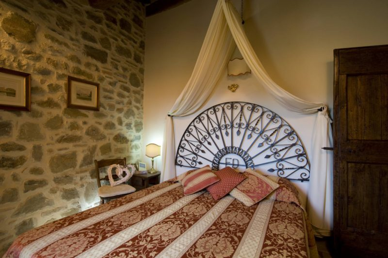 Each headboard is made by ancient pieces of furniture.villa wedding Italy
