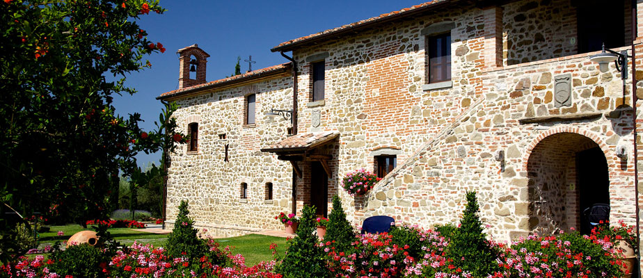 Side view of Wedding villas Italy San Crispolto and outside garden and blooming flowers.