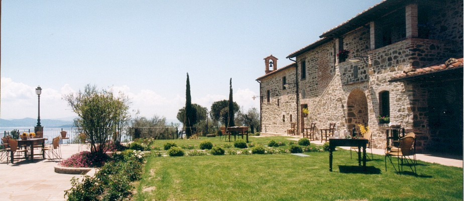Exclusive weddings villa Italy Side view of the terrace and main building.