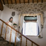Bride is descending the stairs of the wedding suite