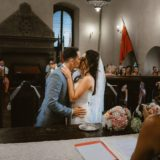 Bride and groom kiss after exchanging the rings, Cortona town hall