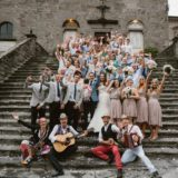 Wedding Prices Italy. Bridal couple, their guests and the Traditional Italian Folk Band at Cortona town hall